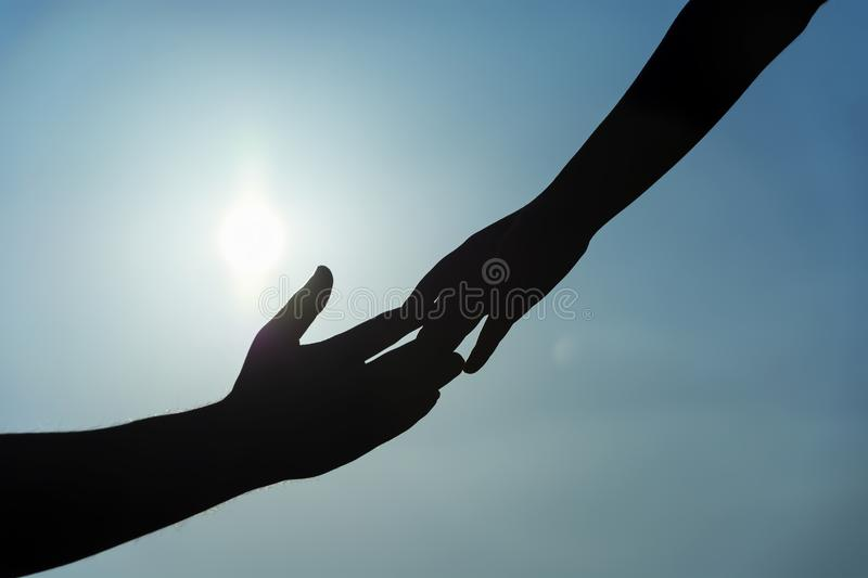Silhouette of helping hand concept and international day of peace. Support. international day of peace.friendship stock photo