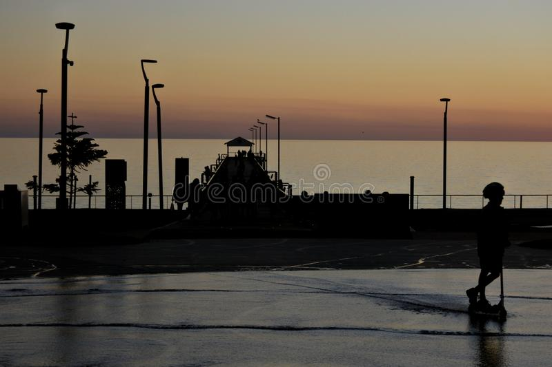 Silhouette of Henley Beach square and pier at dusk in Adelaide South Australia royalty free stock photos