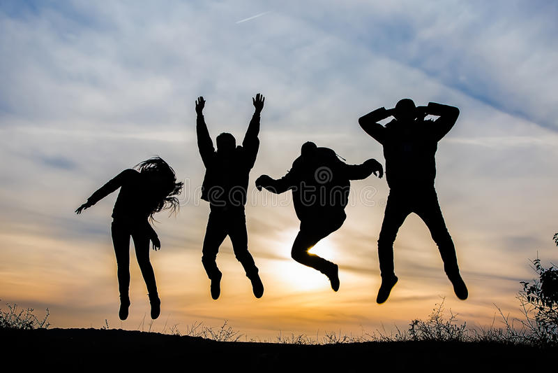 Silhouette heureuse d'équipe photos stock