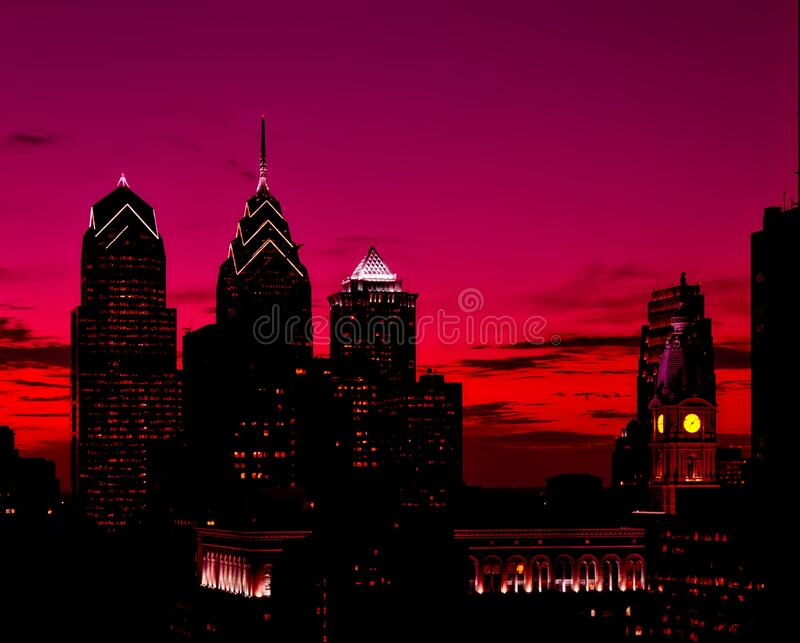 Silhouette of High Rise Buildings at Sunset stock photo