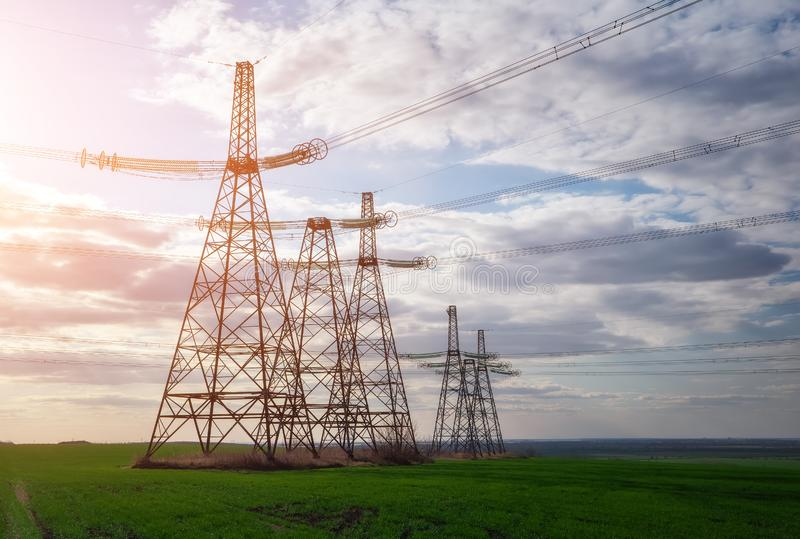 Silhouette High voltage electric towers. High-voltage power lines. Electricity distribution station stock photo
