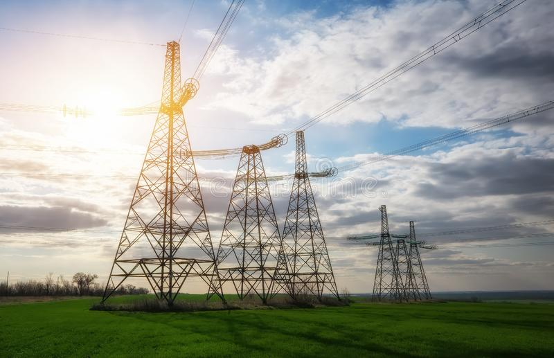 Silhouette High voltage electric towers. High-voltage power lines. Electricity distribution station royalty free stock photo
