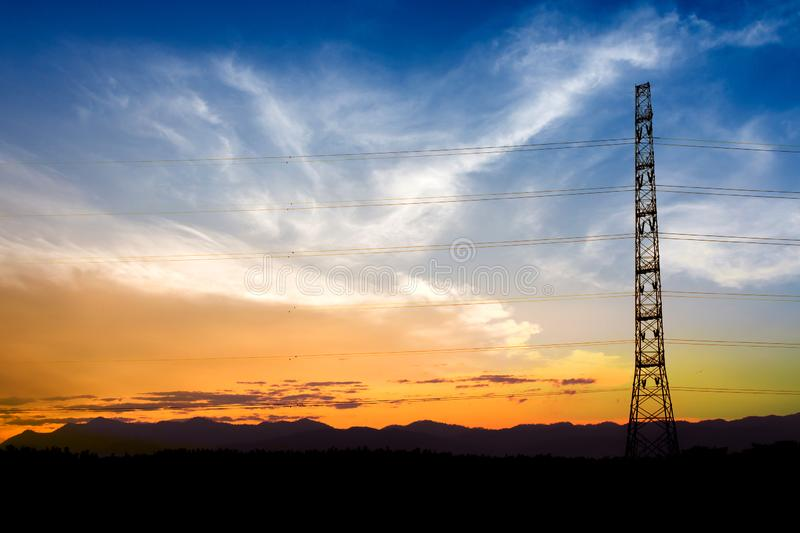 Silhouette of high voltage electrical pole structure. Built, cable, cabling, circuit, conductor, connection, current, danger, distribution, electricity stock photos
