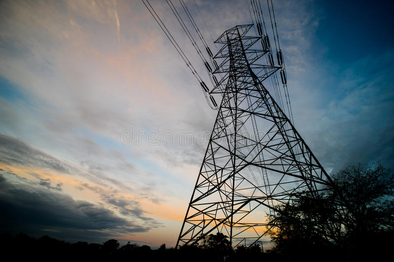 Silhouette of High Voltage Electrical Pole Structure stock image