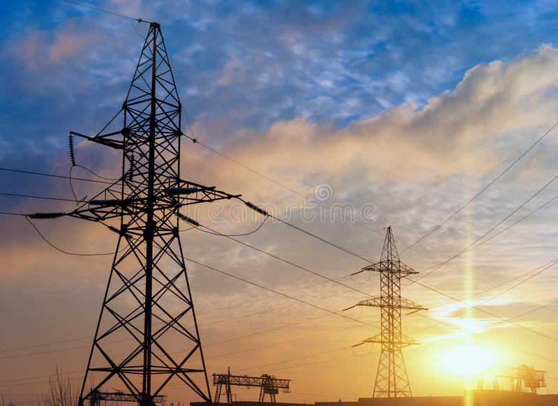 Silhouette of high voltage electrical pole. Sunset sky background. royalty free stock photo