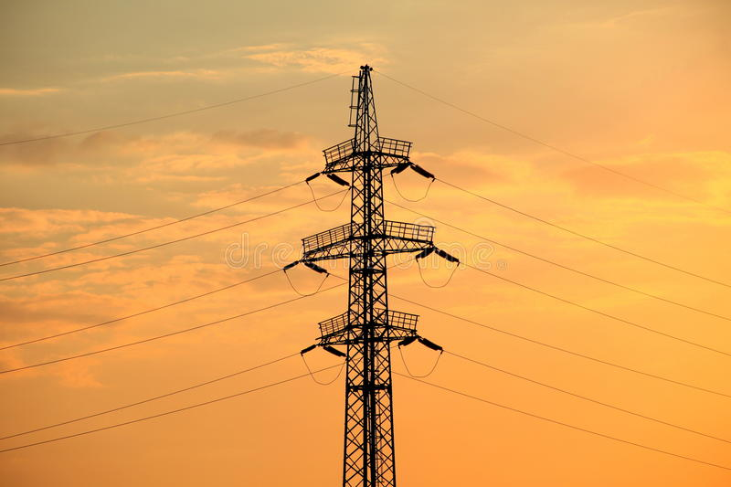 Silhouette of high-voltage mast and power line. royalty free stock photo