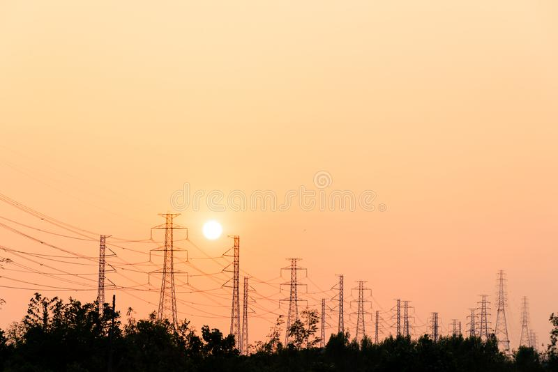 Silhouette high voltage pole on sky sunset background stock image