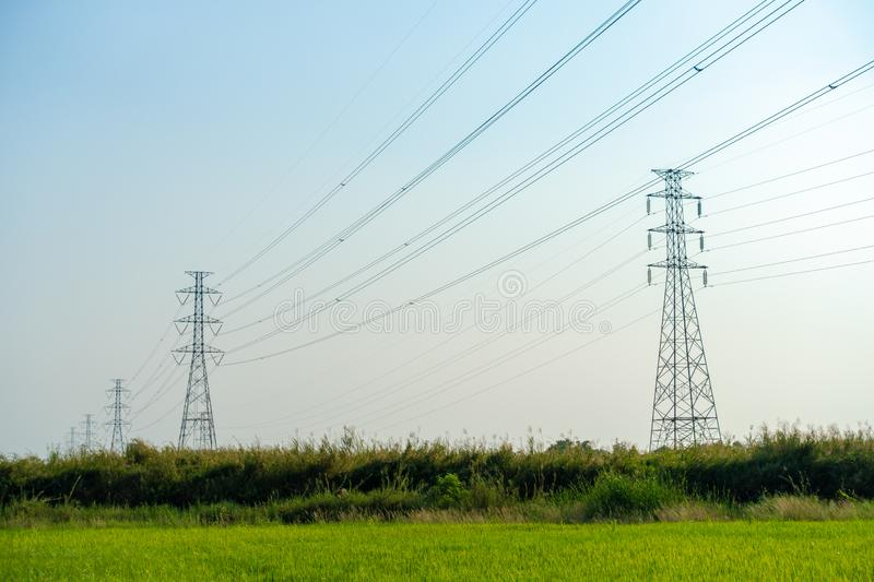 Silhouette high voltage pole on sky sunset background royalty free stock photography