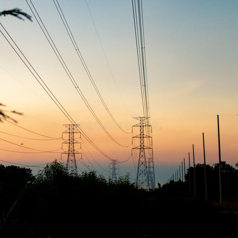 Silhouette high voltage pole on sky sunset background stock photo