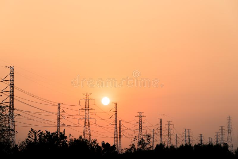 Silhouette high voltage pole on sky sunset background. royalty free stock photos