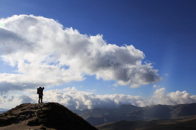 Silhouette of hiker in the Romanian Carpathian mountains. In this photo you can see silhouette of hiker in the Romanian Carpathian mountains stock photo
