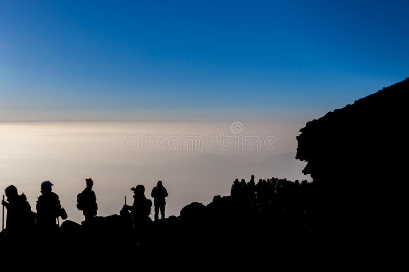 Silhouette of Hikers. On the top of Mt. Fuji royalty free stock photo