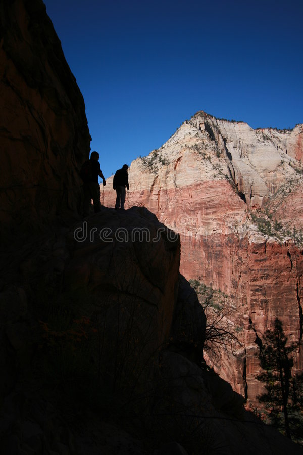 Silhouette hiking in zion. Silhouette of two hikers in zion canyon national park utah stock image