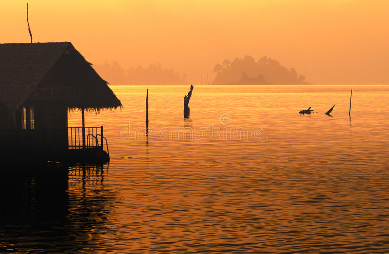 Silhouette home stay on lake stock photos