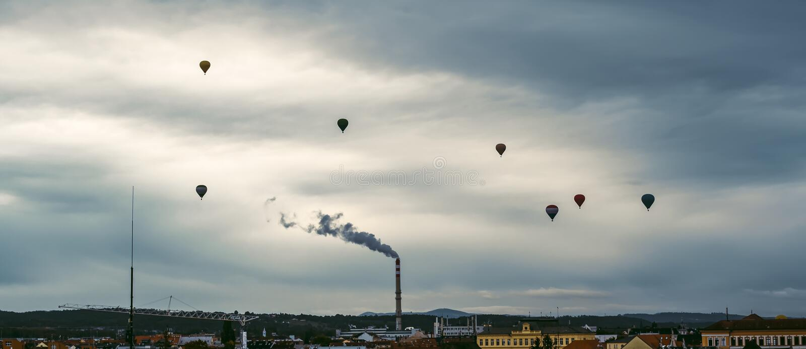 Silhouette of hot air ballons fly above city Ceske Budejovice, Czech republic stock images
