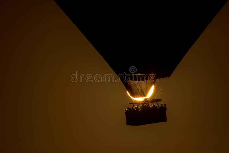 Silhouette of a hot air balloon exactly over the sun.  royalty free stock photo