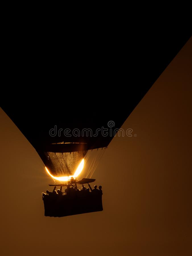 Silhouette of a hot air balloon exactly over the sun.  royalty free stock image