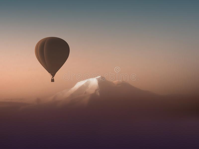 Silhouette hot air balloon flying over the mountains stock images