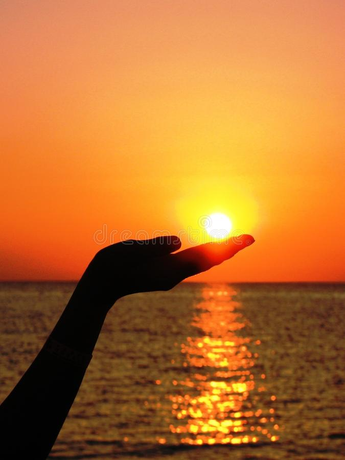 Silhouette Of Human Hand Holding The Sun Set Near Ocean Photography Free Public Domain Cc0 Image