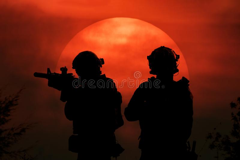 Two soldiers with big sun background royalty free stock photo