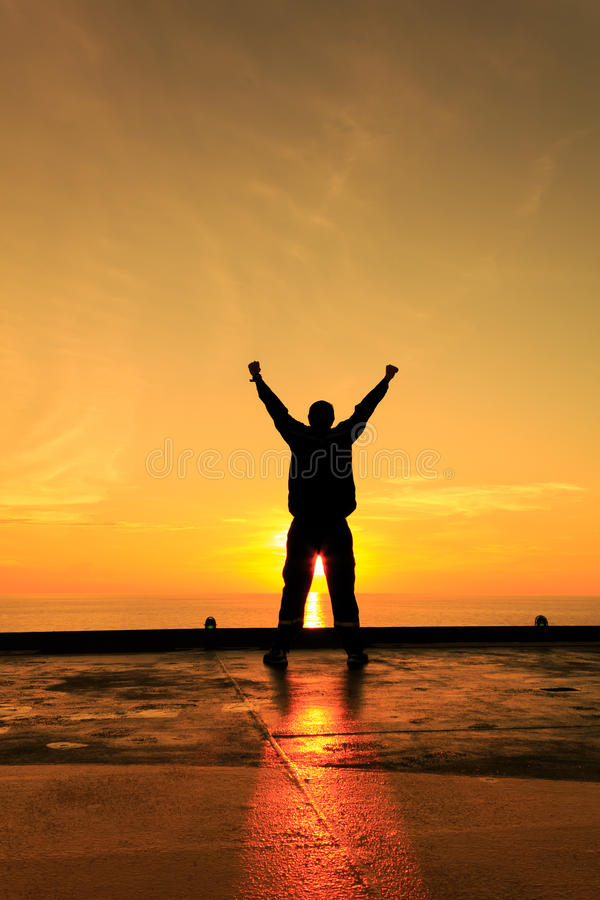 Silhouette Image of Happy Man Showing Winner Action royalty free stock photo