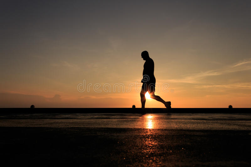 Silhouette Image of man walking on the helideck stock photos