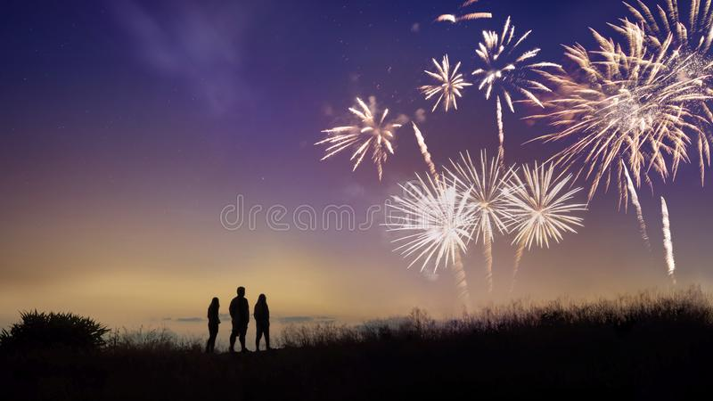 The silhouette image of people looks at the fireworks royalty free stock photo