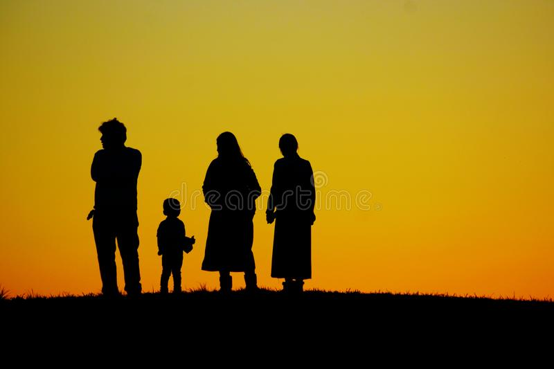 Silhouette image of two-family family royalty free stock photo
