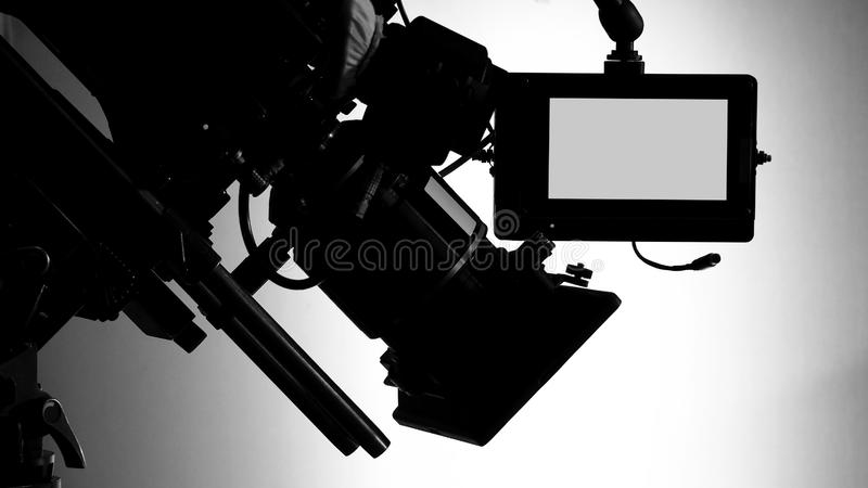Silhouette images of video camera in tv commercial studio production royalty free stock photography
