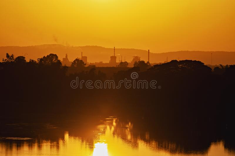 Silhouette,Industrial plant is located on the river, stock images