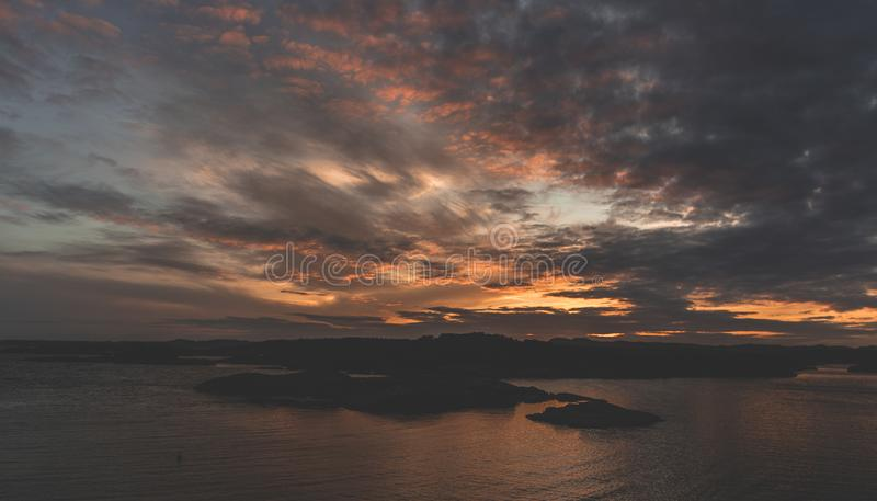 Silhouette of Island during Sunset royalty free stock photos