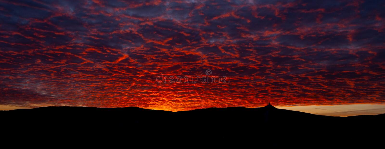 Silhouette of Jested mountain at sunset time with beautyifully illuminated evening sky, Liberec, Czech Republic.  stock image