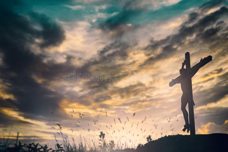 Silhouette of Jesus with Cross over sunset concept for religion, worship, Christmas, Easter, Redeemer Thanksgiving prayer and royalty free stock photo