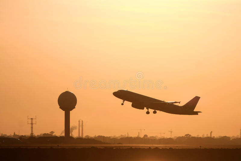 Download Silhouette Of Jet Airliner In Flight Stock Photo - Image: 27576438