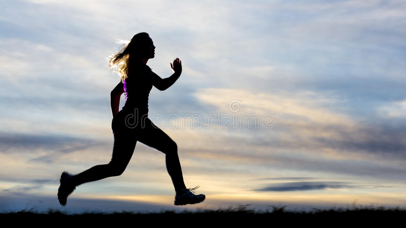 Silhouette of a jogger in sundown royalty free stock image