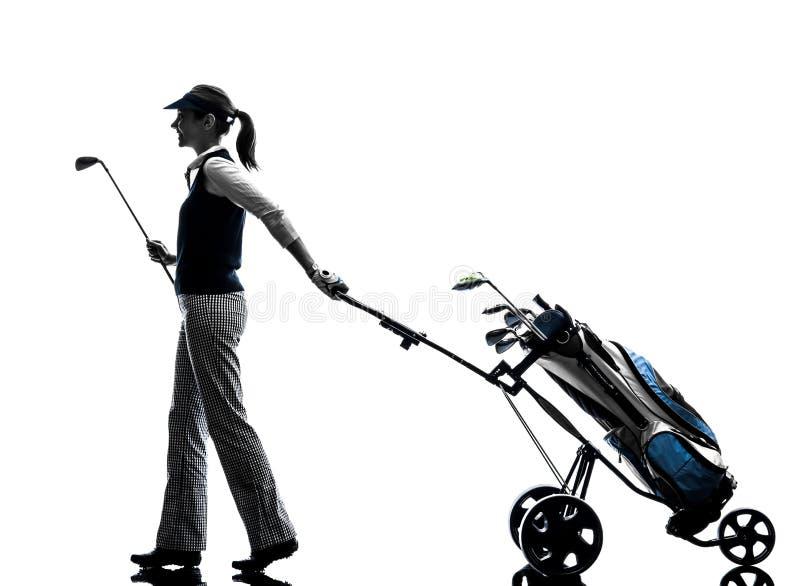 Silhouette jouante au golf de golfeur de femme images libres de droits