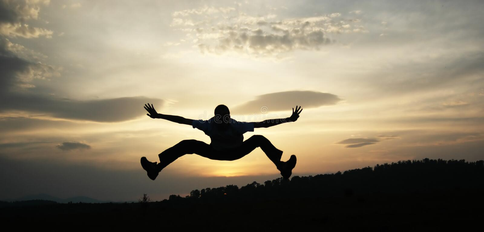 Silhouette jump in sky royalty free stock photography