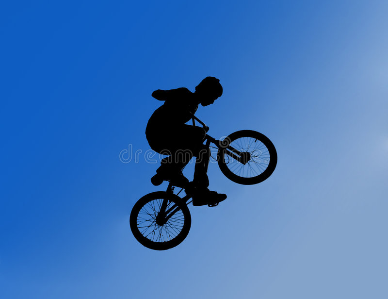 Silhouette of jumping boy royalty free stock image