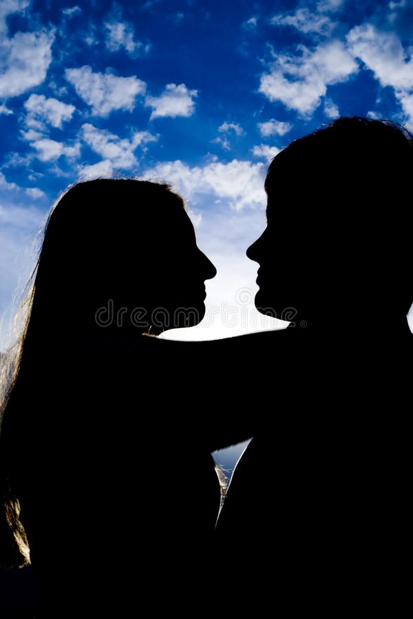 Silhouette of kissing people royalty free stock photos