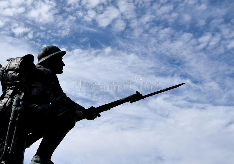 Silhouette of a kneeling WWI soldier statue stock image