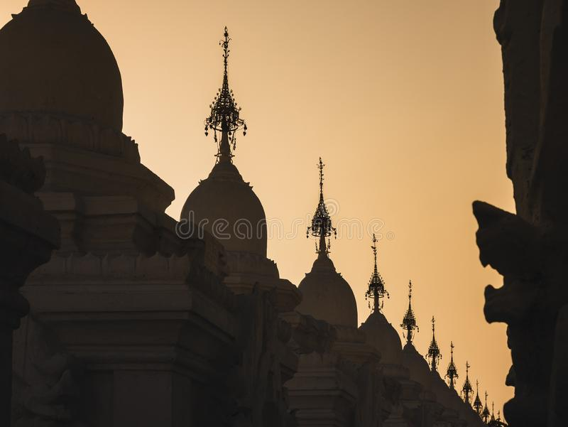 Silhouette of Kuthodaw Pagoda Buddhist stupa located in Mandalay Art Architecture Travel. Sunset time stock photos