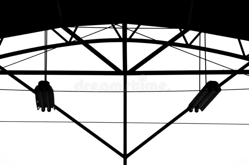 Silhouette of lamp is hanging at building structure. Background stock photos