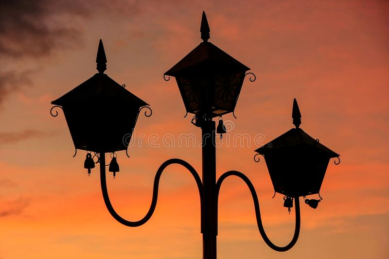 Silhouette of a lamp post at sunset at Sutaungpyei Pagoda on the. Top of Mandalay Hill, Mandalay, Myanmar. Mandalay Hill has been a major pilgrimage site for stock photo