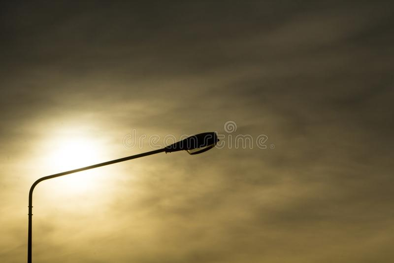 Silhouette of lamp spot,evening time stock image