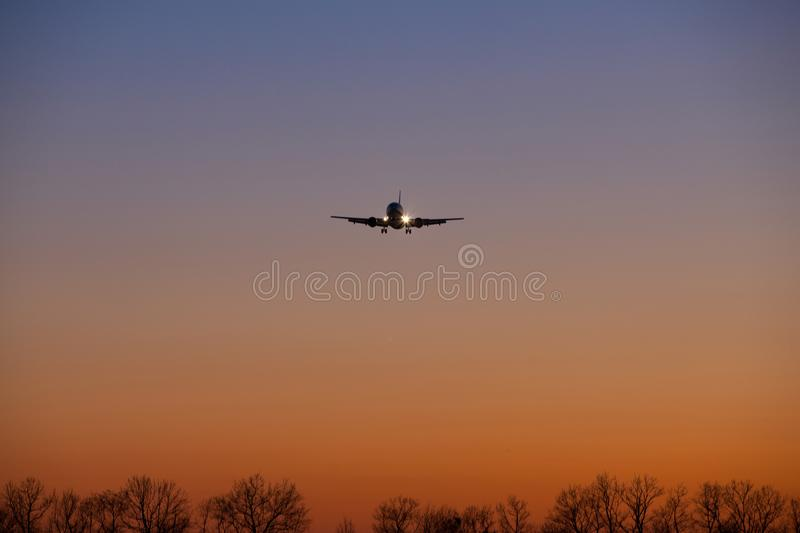 Silhouette from a landing plane. royalty free stock photography