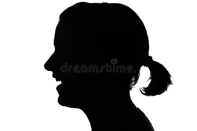Silhouette of a laughing girl stock images