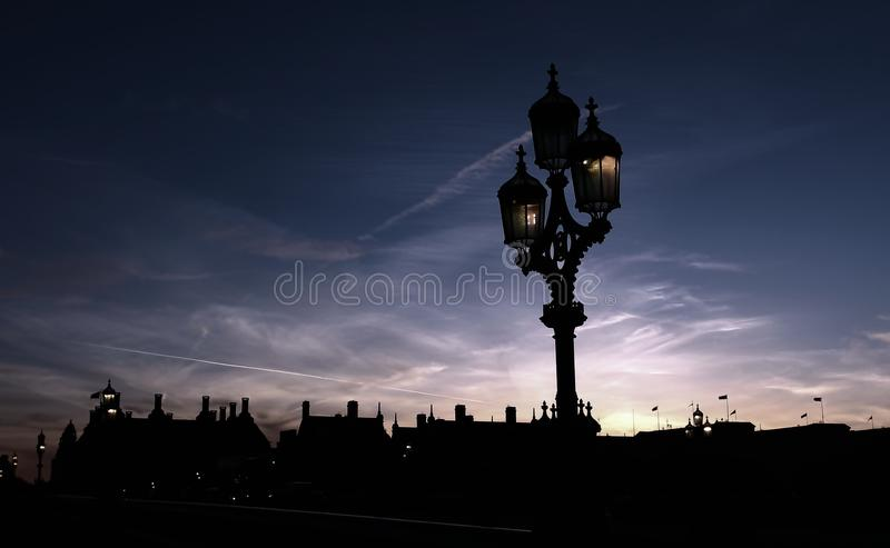 Silhouette. The light hold blue sky background blue royalty free stock images