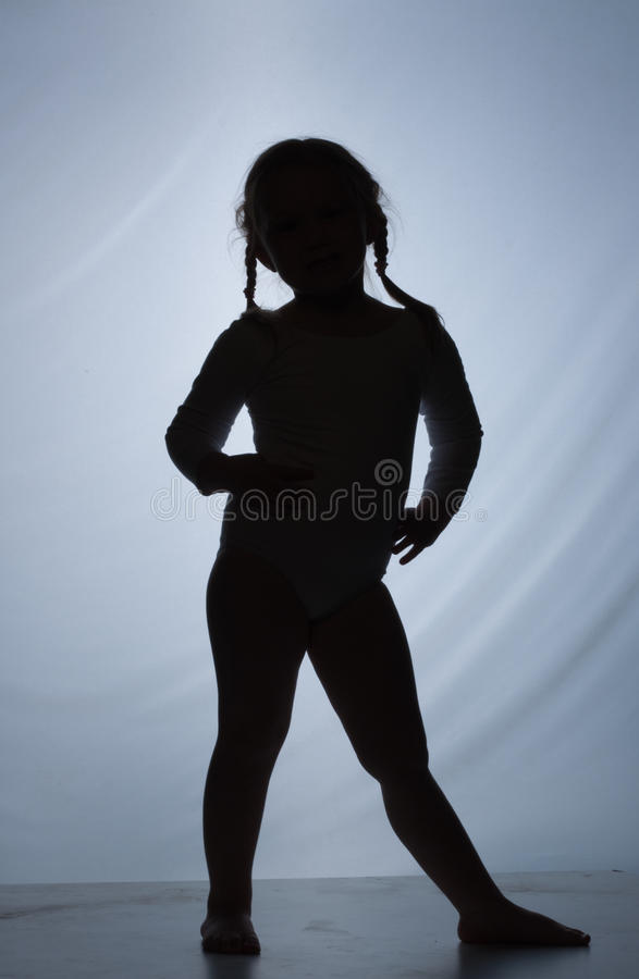 Silhouette of little cute girl on a blue backgroun royalty free stock photography