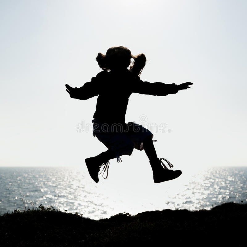 Silhouette Of A Little Girl Jumping - 44.4KB