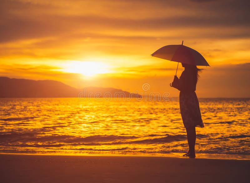 Silhouette lonely and depressed woman holding an umbrella royalty free stock image